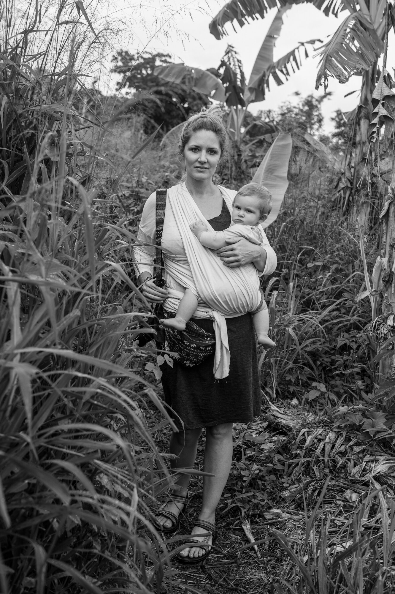 Woman and her baby hiking through the jungle, Mele Cascades, Efate, Vanuatu