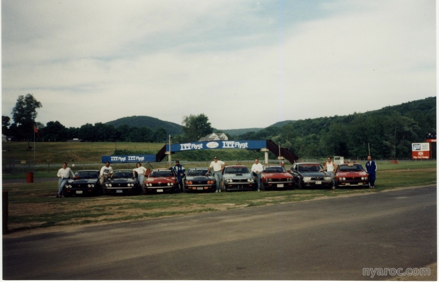 Team Shoestring (a/k/a The Alfa Boys, GTV6 Chapter) group photo in the paddock at Lime Rock