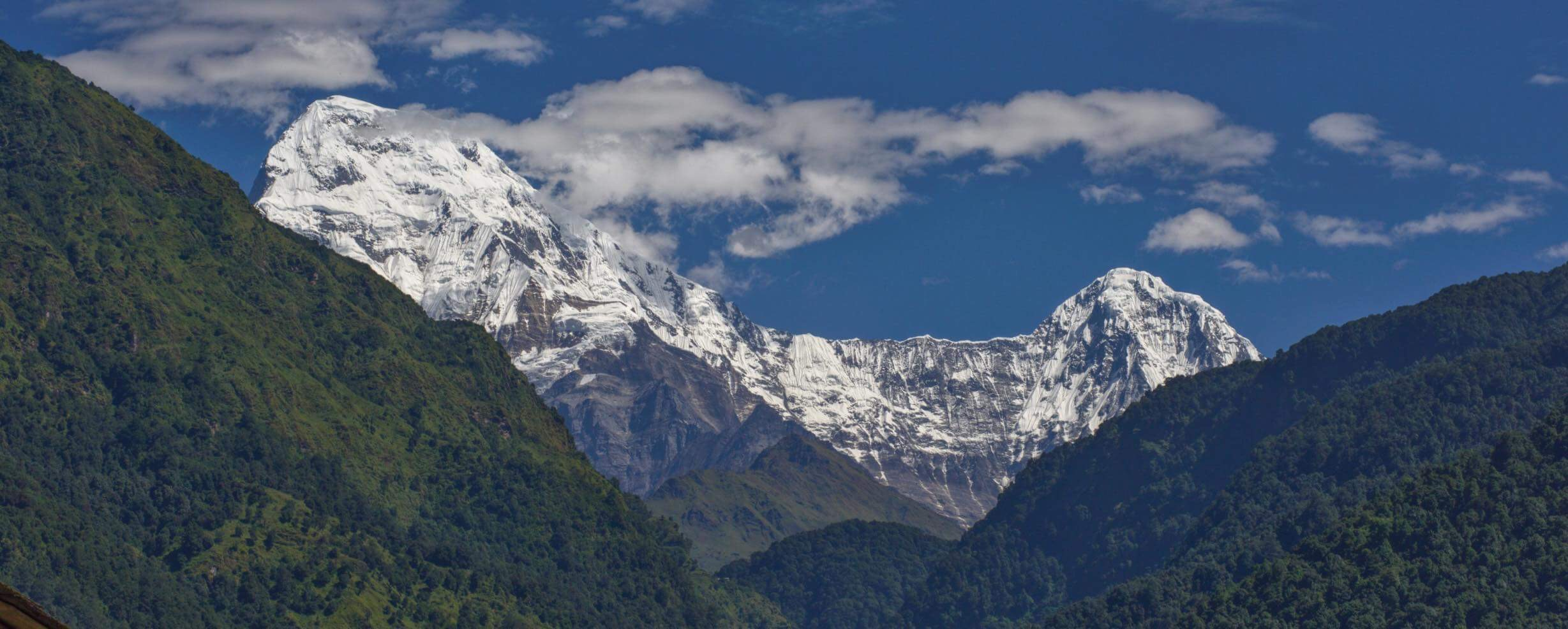 In the shadow of Annapurna South (Pictured Left)