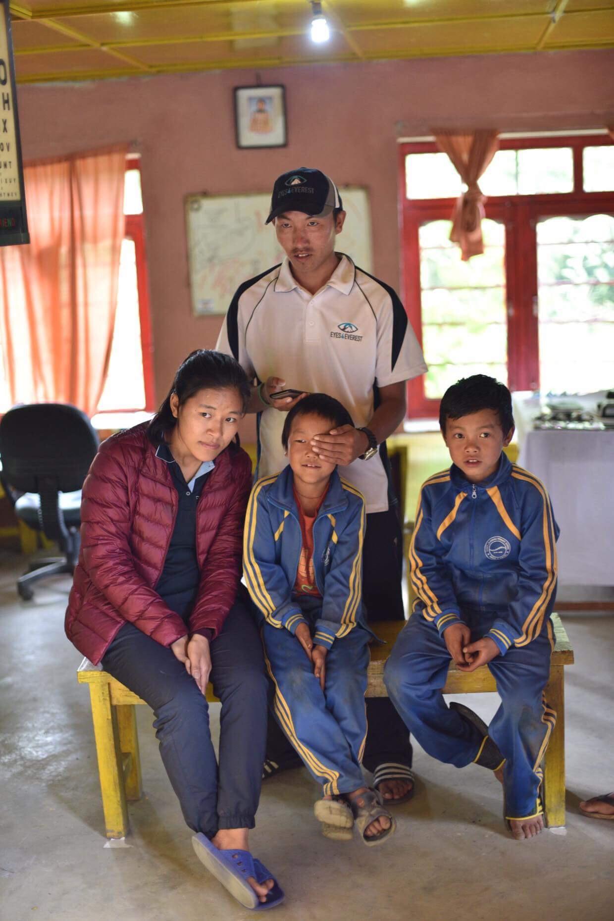 Tashy and Kami testing the local school children