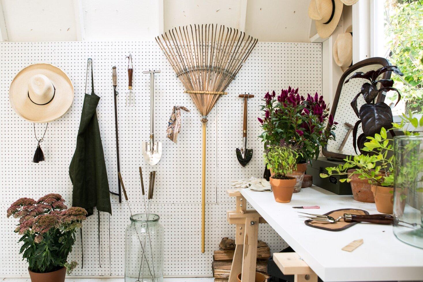 garden-shed-pegboard-storage-tools-michelle-adams-ann-arbor-by-marta-xochilt-perez-1466x977.jpg