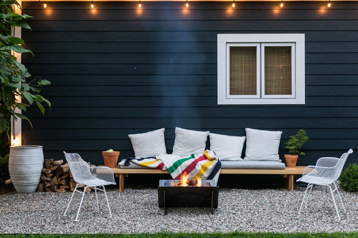 fire-pit-gravel-patio-seating-string-lights-michelle-adams-ann-arbor-by-marta-xochilt-perez-1466x977.jpg