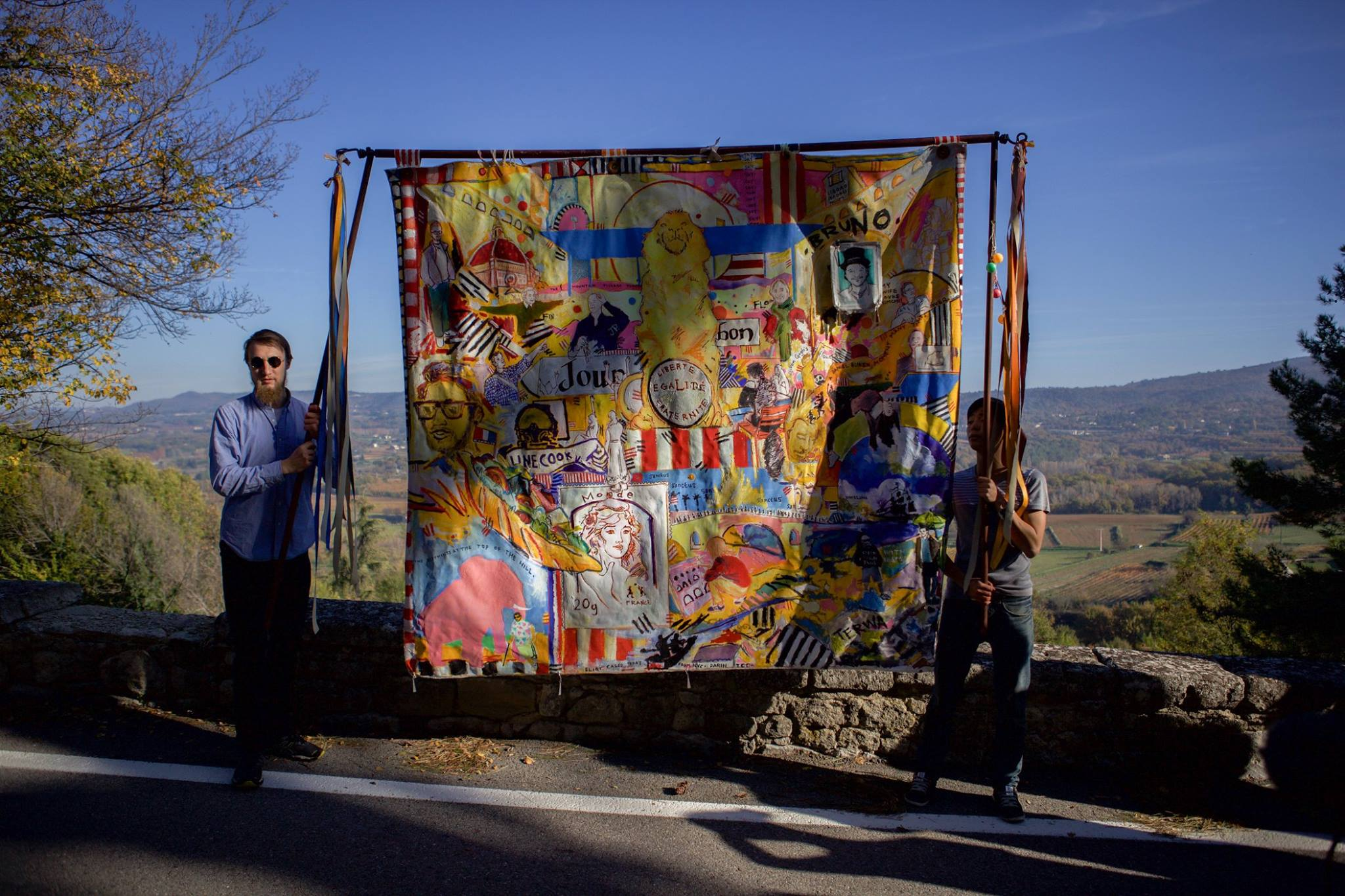Front view of Rex Hausmann's painting, carried by Wai Pong Tong and Sean Taillefer.