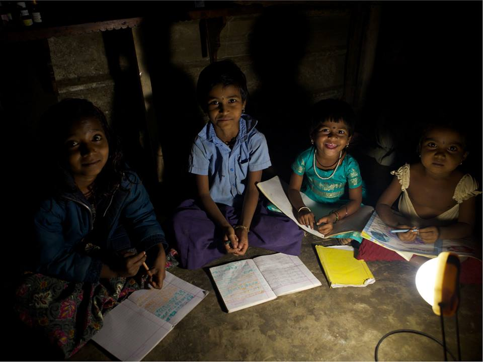 Studying with a solar lamp  (Source:  Pollinate Energy )