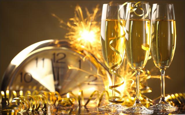 Happy-New-Year-Fireworks-Sky-Clock-Ribbons-Wine-Glass.jpg