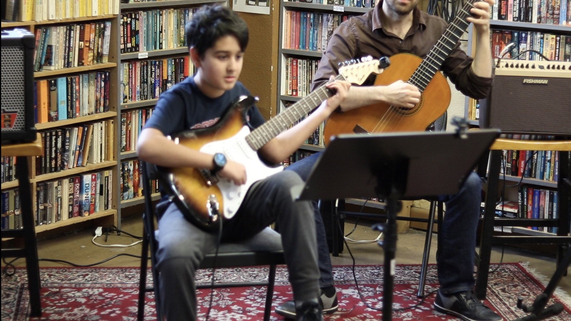 A guitar student and instructor Ken Elia performing a duet for our holiday recital