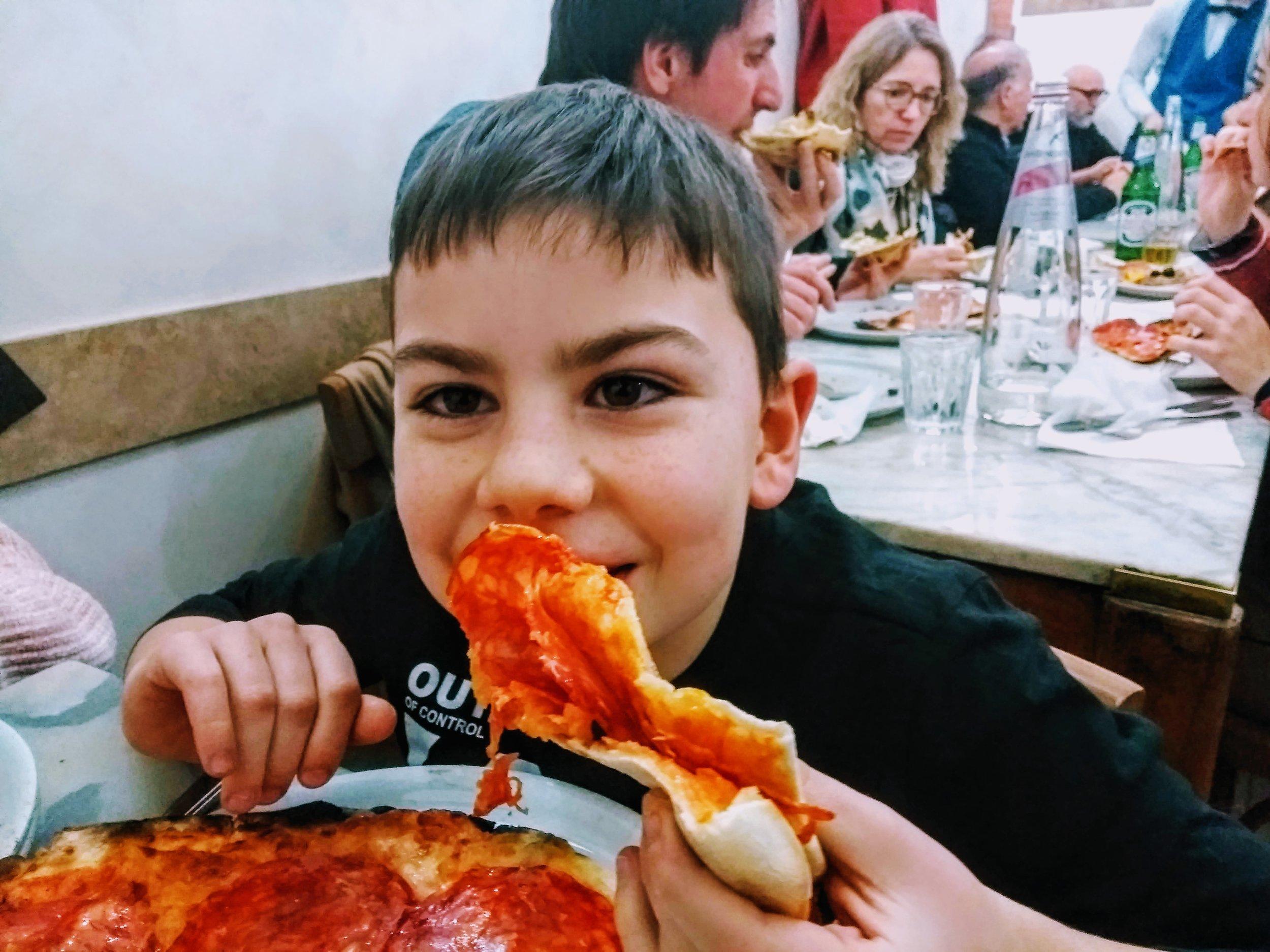 Romeo eating pizza.jpg
