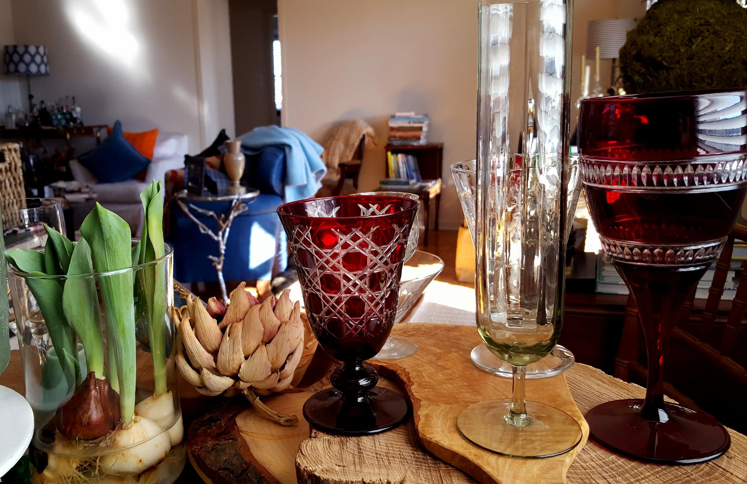 Glasses from left: Garnet Goblet, Antique Champagne Flute, and Garnet White Wine Glass.