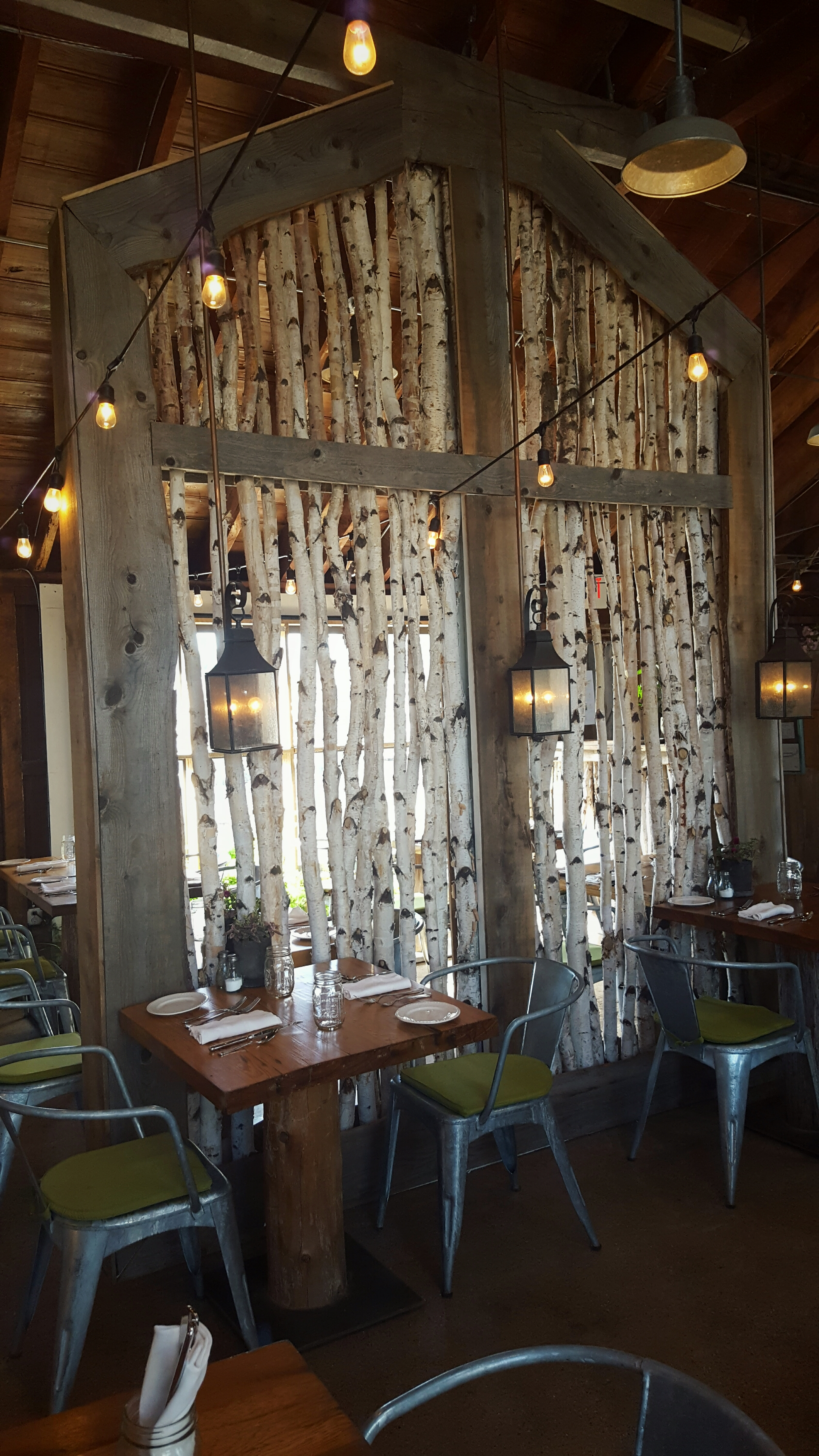 These white birch poles can be found everywhere now (even at HomeGoods and TJ Maxx). Your local contractor can make this for you as a backdrop at a barn wedding or party!