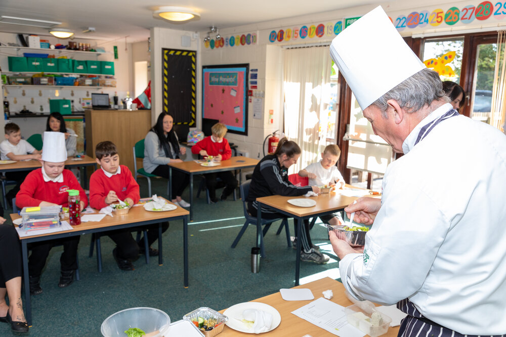Chef James Holden demonstrating some cookery skills to the students