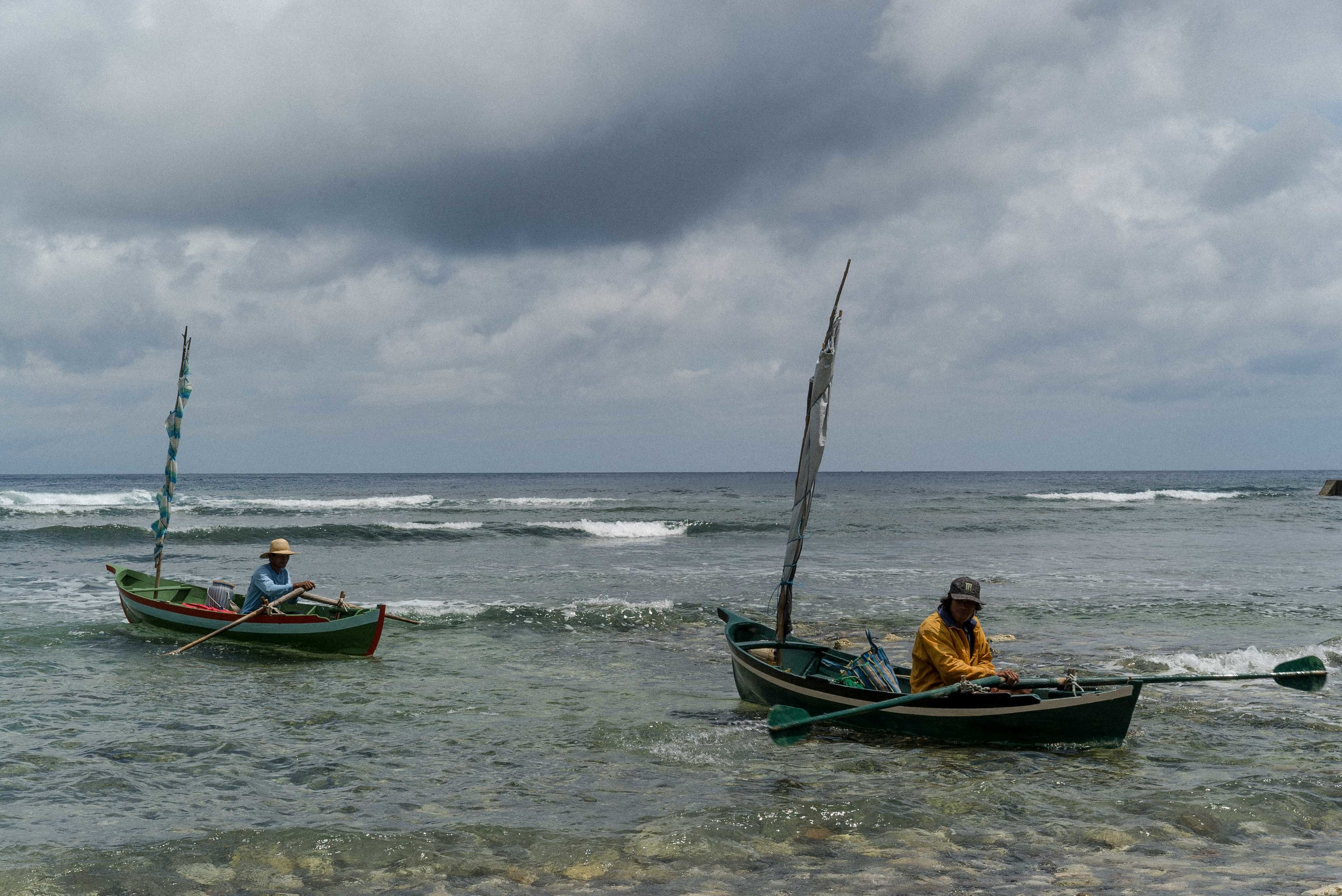 By 11AM Mahatao fishermen paddle back to the shore.