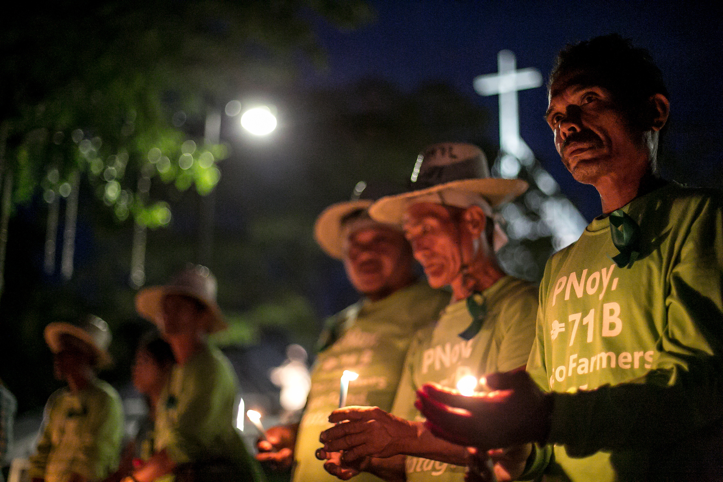 """QUEZON CITY, PHILIPPINES — The coconut farmers of the  KM71 Martsa ng Magniniyog held a prayer vigil at the Ateneo de Manila University on 20 November 2014. They marched from Davao City to Malacañang to speak with former President Benigno """"Noynoy"""" Aquino III about the return of the Coco Levy Trust Fund."""