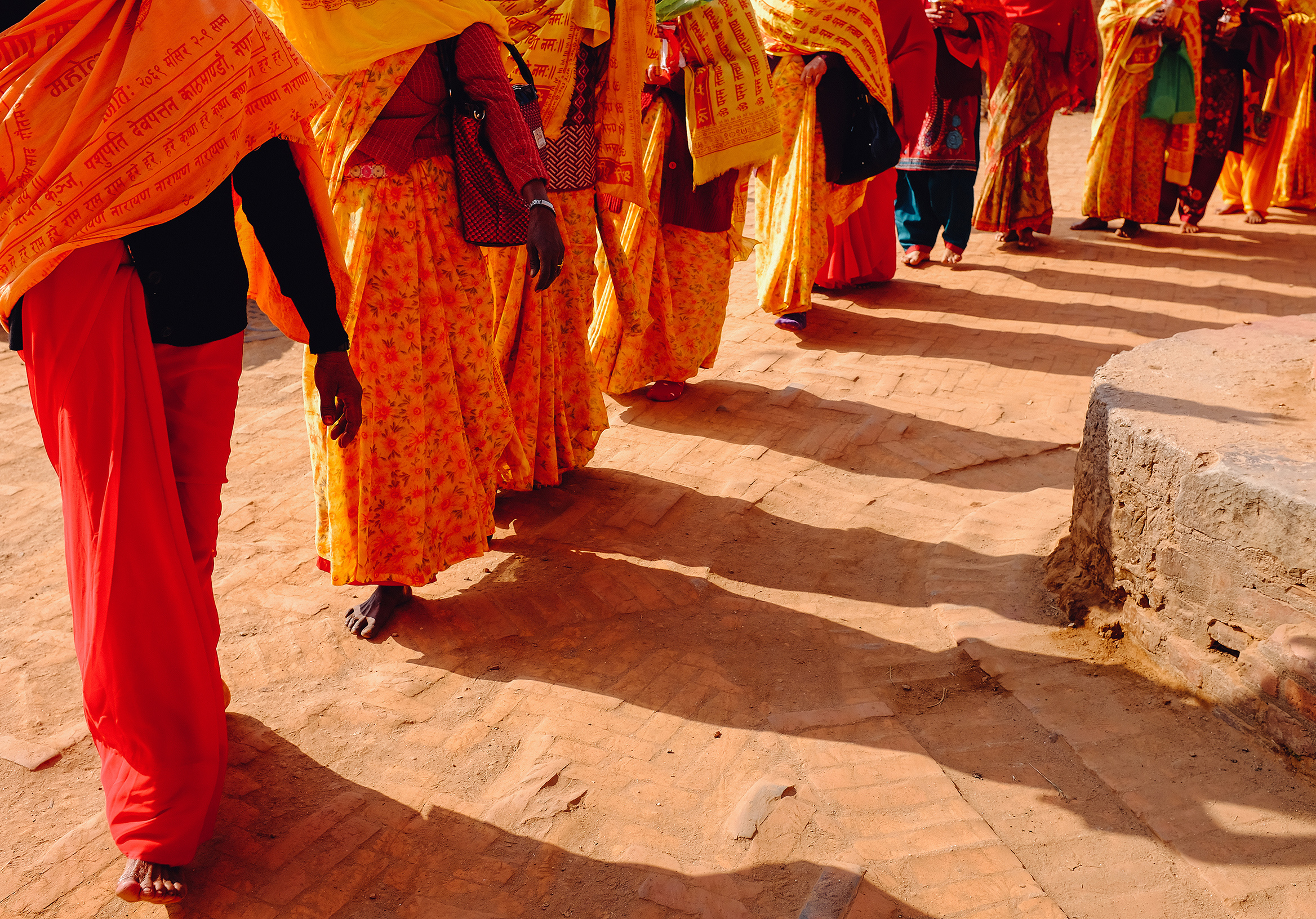 BHAKTAPUR, NEPAL  —  Women in the village walk barefoot during a procession for a deceased leader.