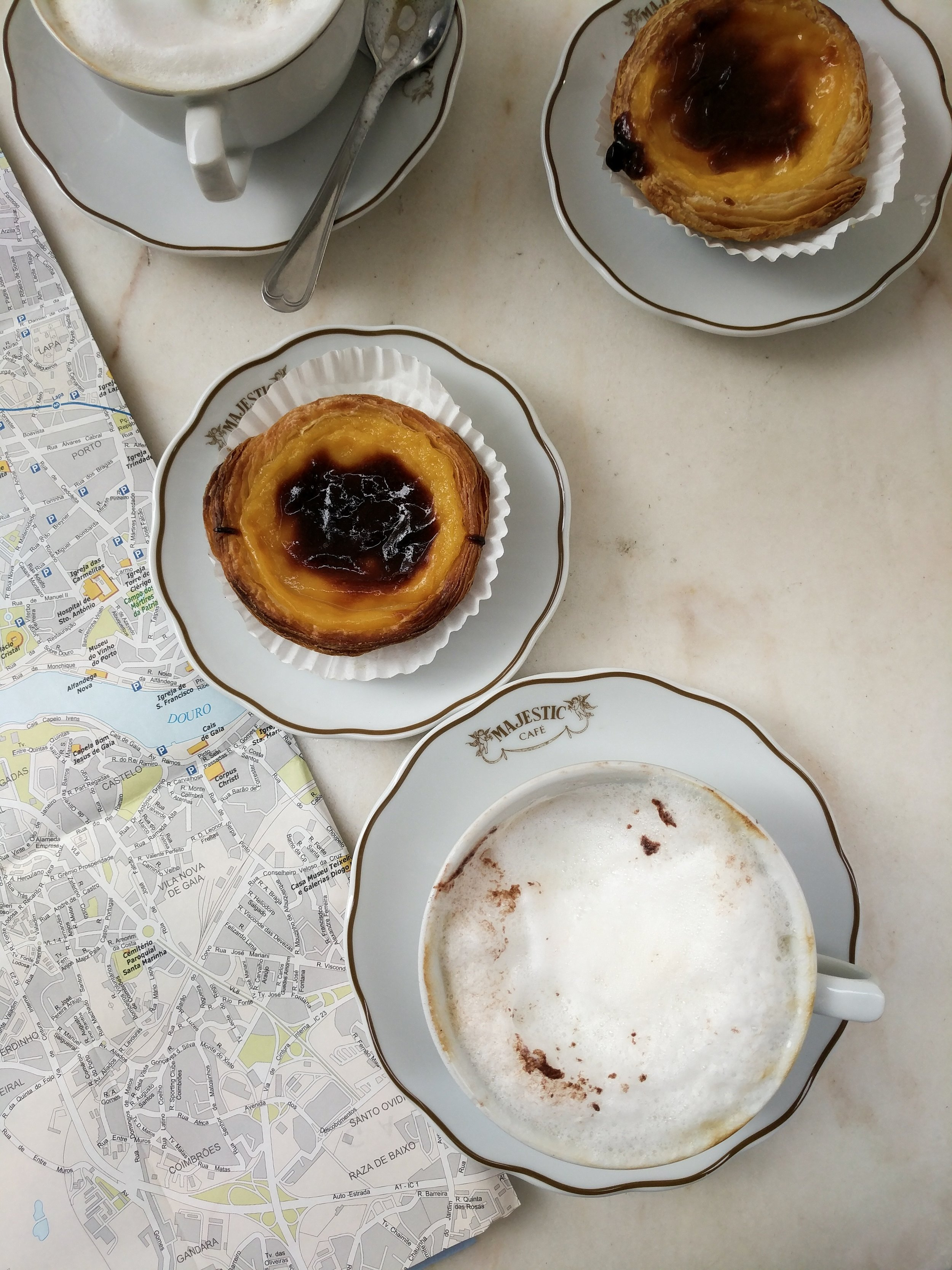 Cappuccino and Pastel de Nata at Majestic Cafe
