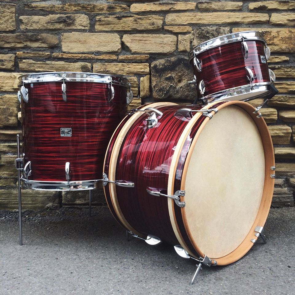 """1960's Beverley New Standard in Red Swirl, sized 20,12,16"""". Birch shells with beech rerings. Finished with bare wood finish hoops."""