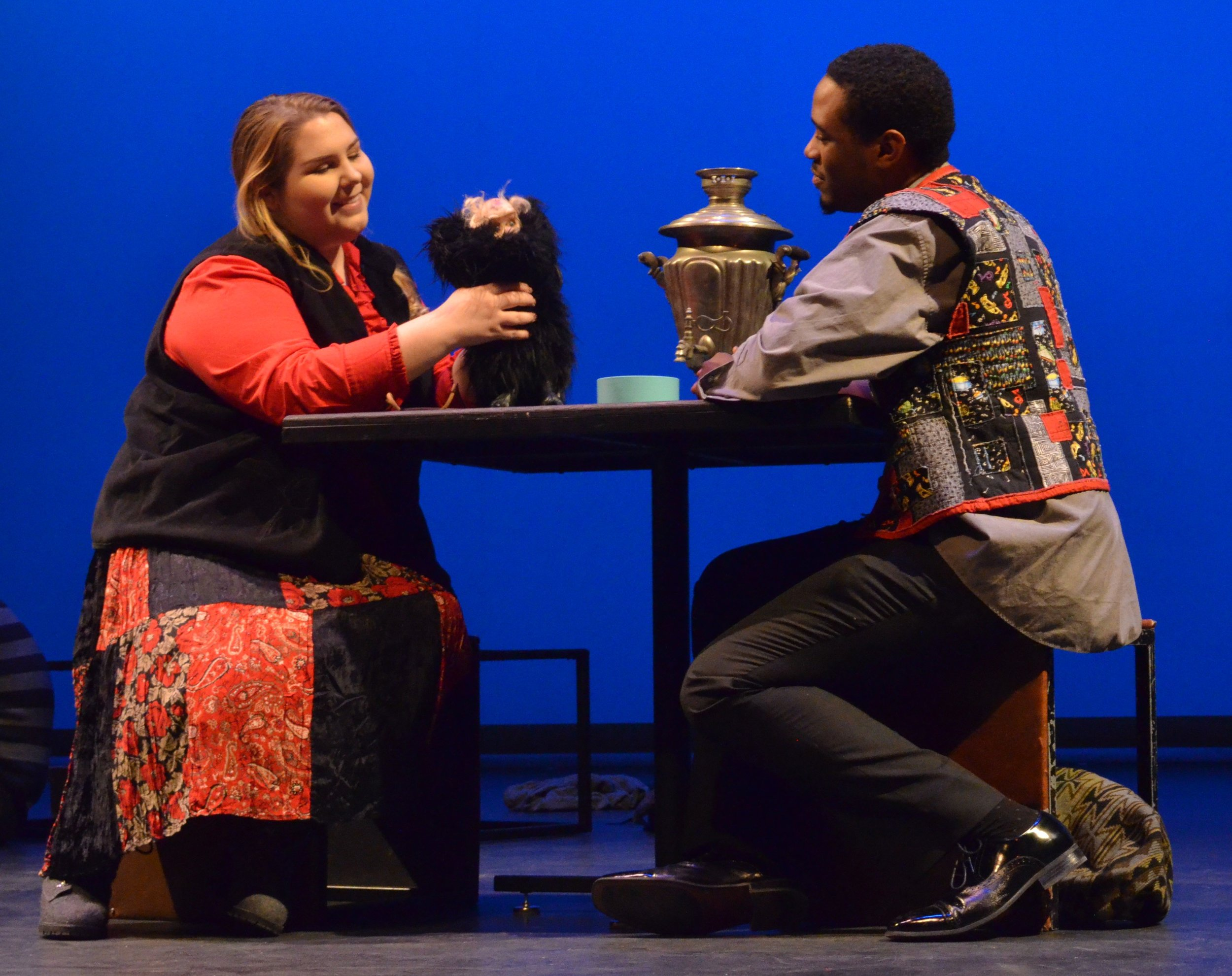 Sadie Cheslak and Dean Moore as Jane and John Doe with the puppet of Bi Ba Bo. Lighting design Alena Samoray