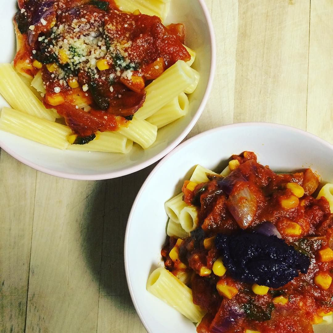 #PastaNight! #Rigatoni with #Ceriello basil sauce. Added purple tomato, a little corn, and spinach to the sauce. Garnished with Parmesan for the hubby and #blackolive #tapenade for myself. Took all of 20 minutes to make. Keep it simple! #simplecooking #quickmeals #bushwick #bushwicknutrition #lazynutrition #lazynutritionist #pasta  http://ift.tt/1HIqSNQ