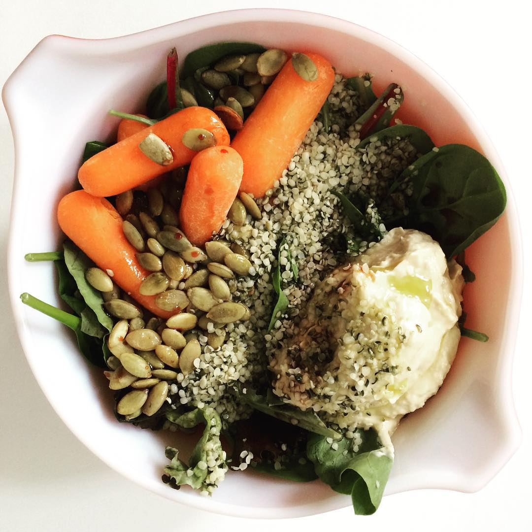 #Salad with a crap load of #veggie #protein from #hempseeds, #pumpkinseeds (#pepitas), and #hummus. One serving of each summed up to 19 grams of protein!   That said- this was a #lightlunch. I usually do this when I know I have a heavier dinner ahead of me. Important to #balance out your day :)  #lazynutritionist #lazynutrition #bushwicknutrition #bushwick #lightlunch #easymeals