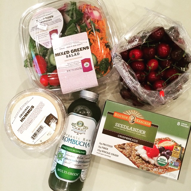 Shopping for a healthy lunch. I usually don't shop @wholefoods since it's a mystery how 5 items equate to $25 spent, BUT compliments of our dear friends @jspicer8 & Farrah, I am splurging. Greens + #hummus (protein) + #crispbread from #DoctorKracker (protein and hardy carb) + #cherries for dessert + #kombucha from @gtskombucha for digestive support. I am all set! #healthylunch #wholefoods #lazynutritionist