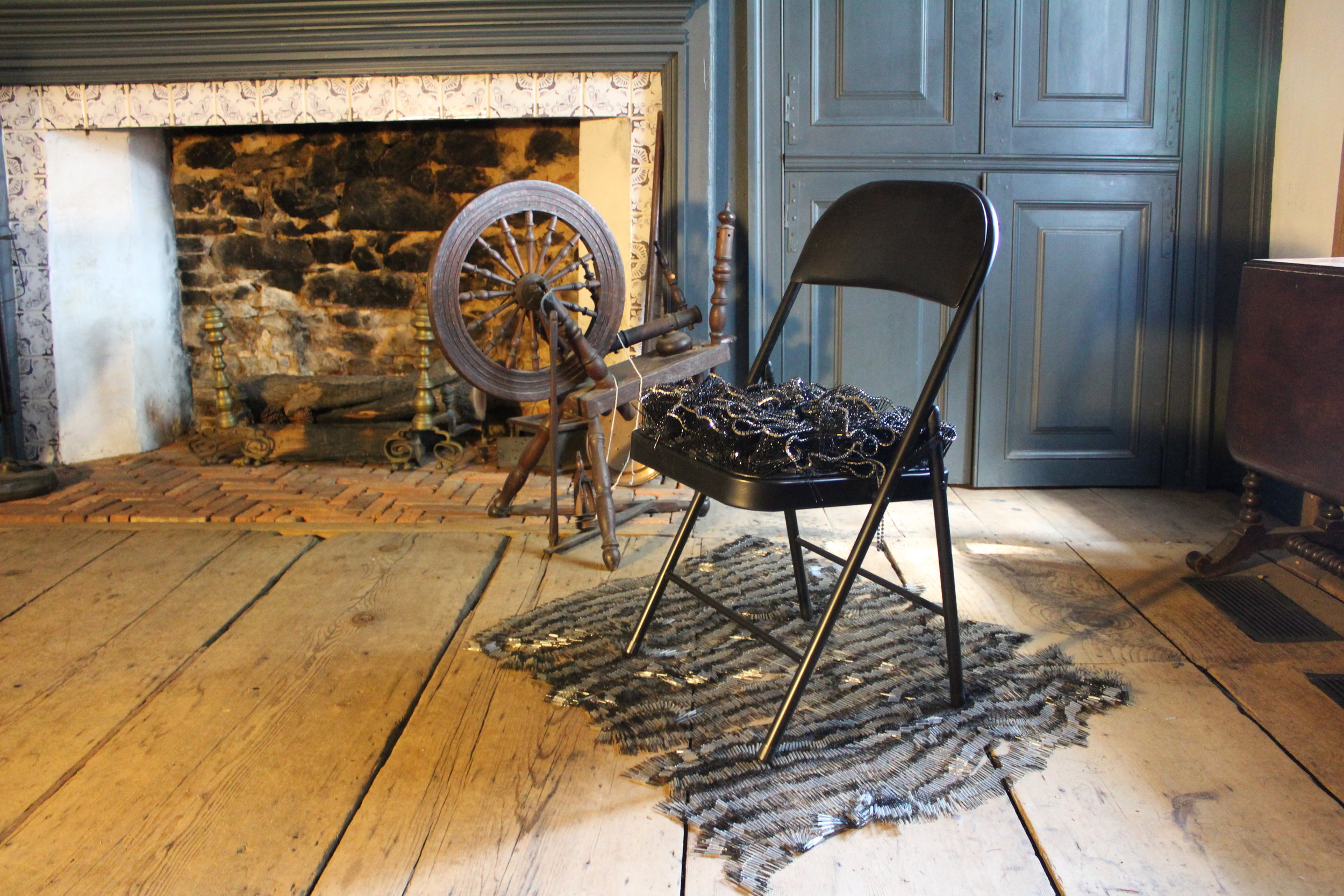 Bobby pins, rhinestone necklaces (some the artist's grandmother's), folding chair, spinning wheel in collection of Wyckoff House Museum, installed at Wyckoff House Museum