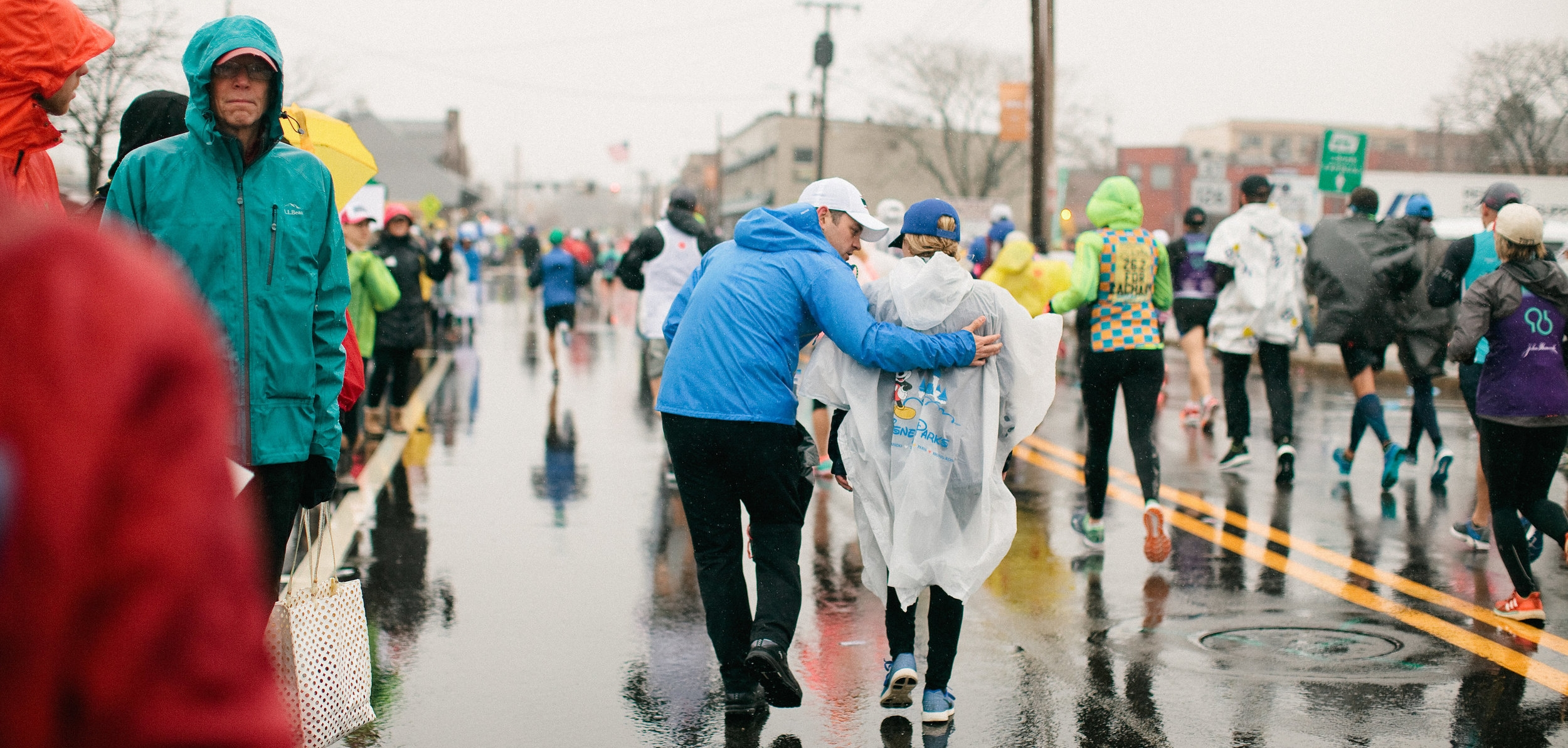 Mile 6 of the Boston Marathon. My husband giving me some encouragement. Photo by Tina Florance