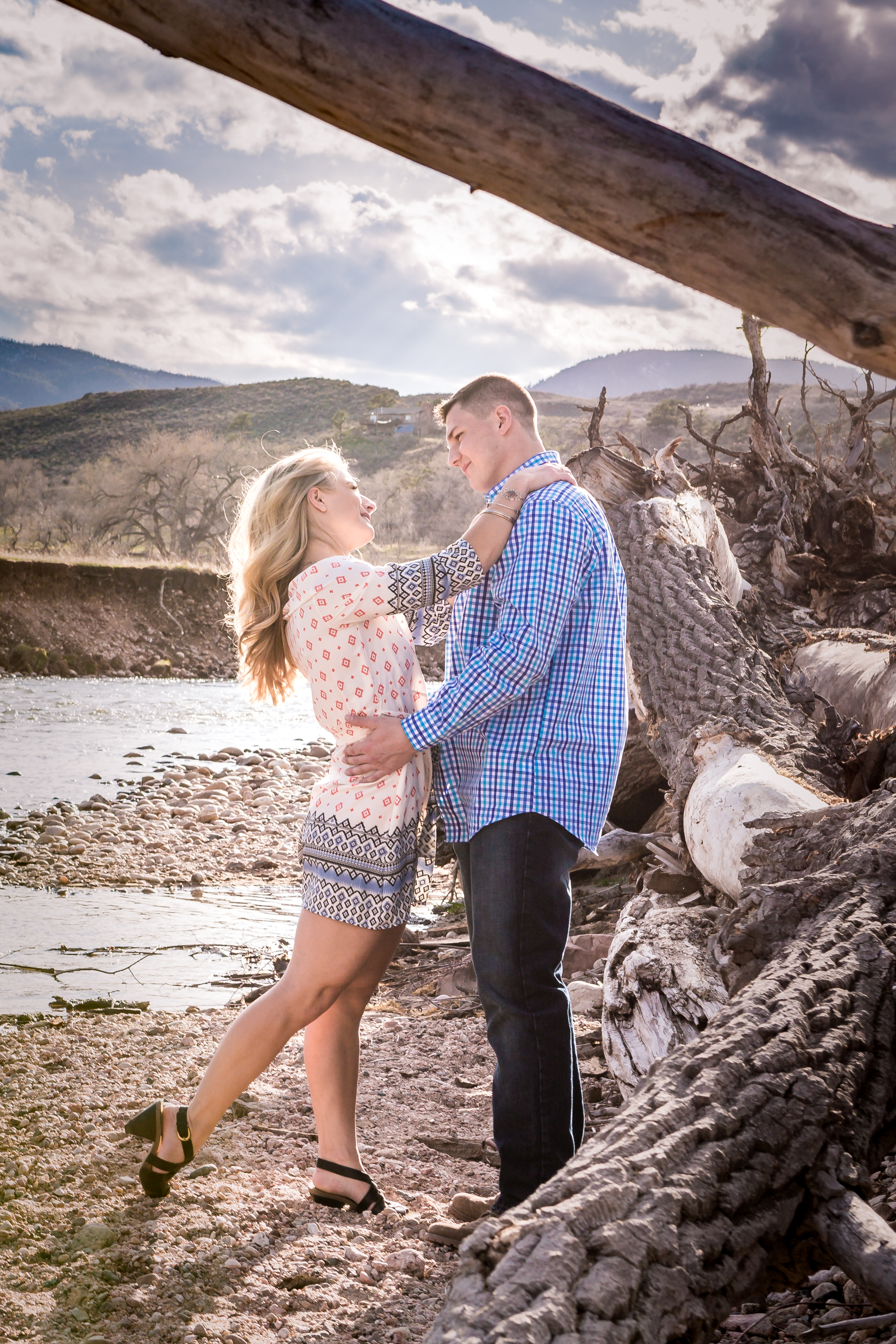 Engagement taken next to the Poudre River, in Fort Collins Colorado by JMGant Photography