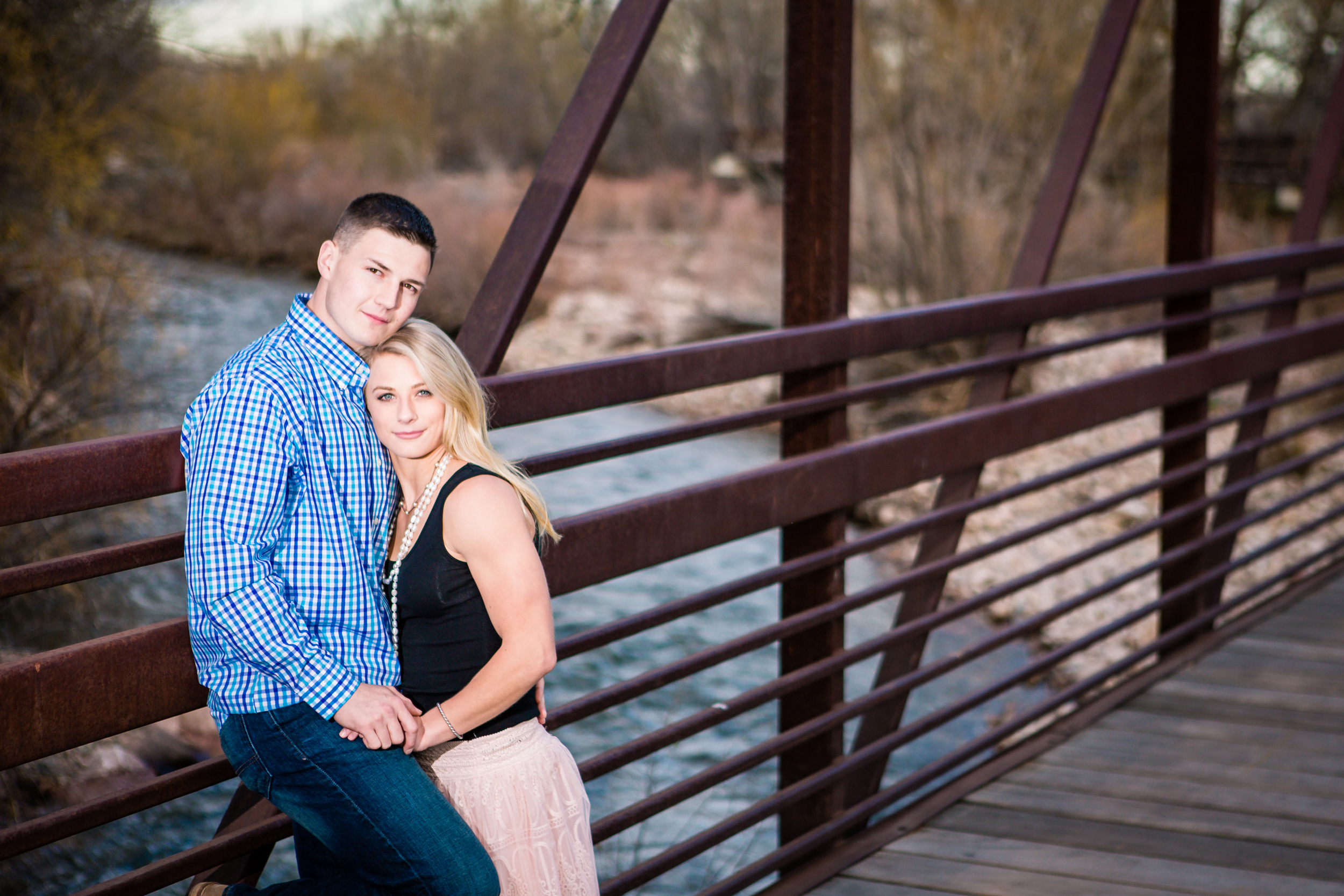 Engagement pictures taken on Lion Park bridge in Fort Collins Colorado by JMGant Photography