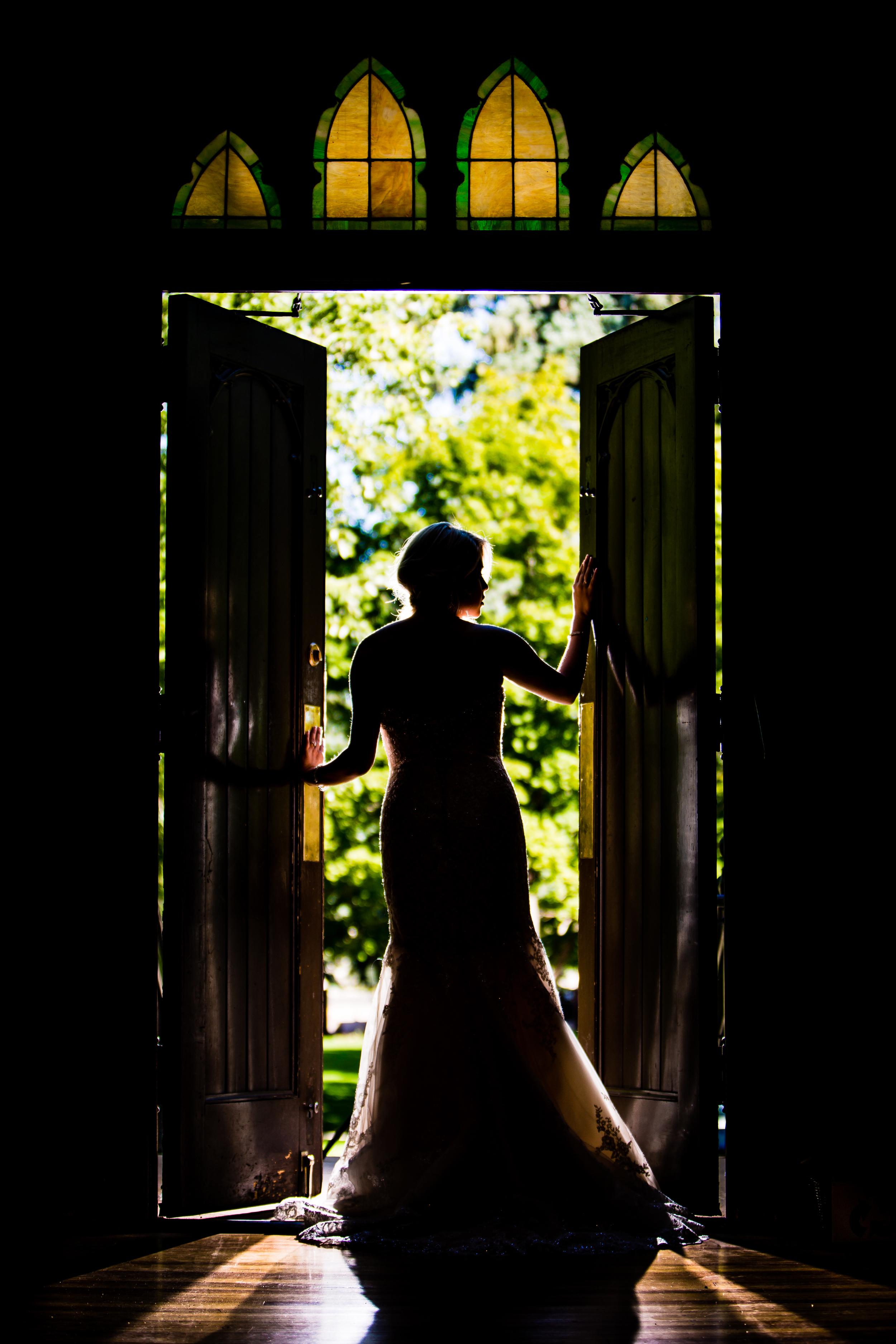 Bride in front of door. www.jmgantphotography.com