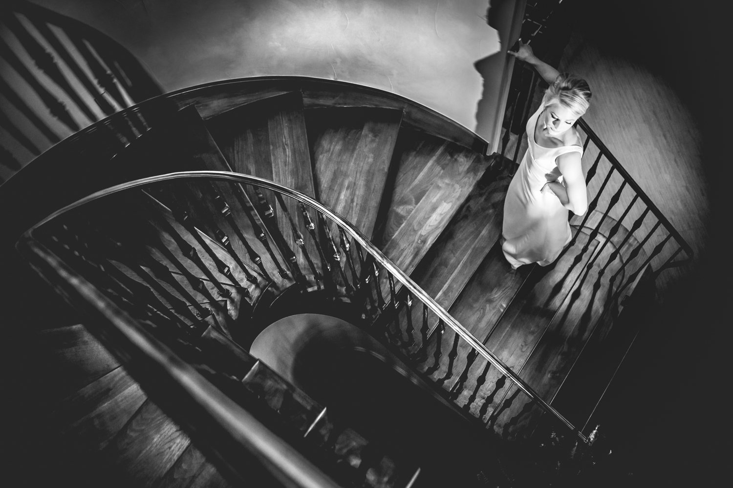 Bride on spiral staircase.  www.jmgantphotography.com