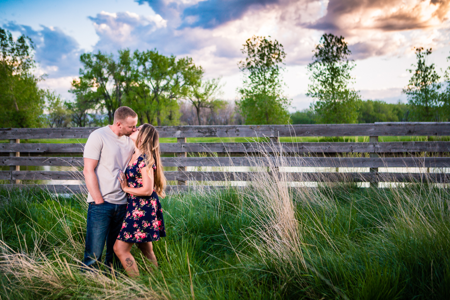 Engagement with a rustic fence at Sandstone Ranch. Take by Jared M. Gant