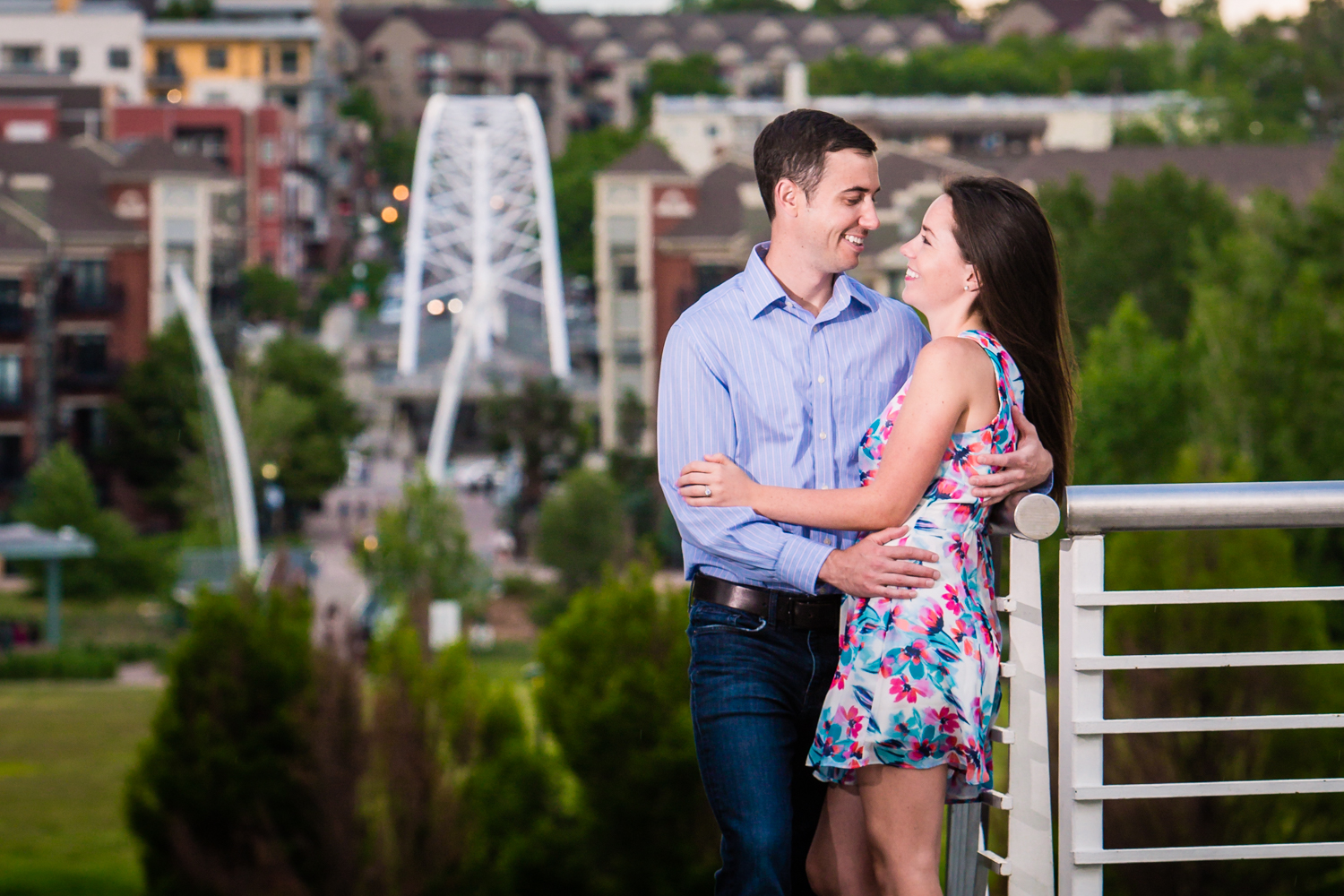 Denver Engagements with Highland Bridge in background. Photographed by Jared M. Gant
