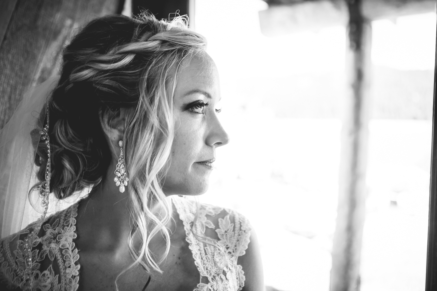 The bride waiting paciently for the ceremony to begin. The barn at Evergreen Memorial. Photographed by JMGant Photography.