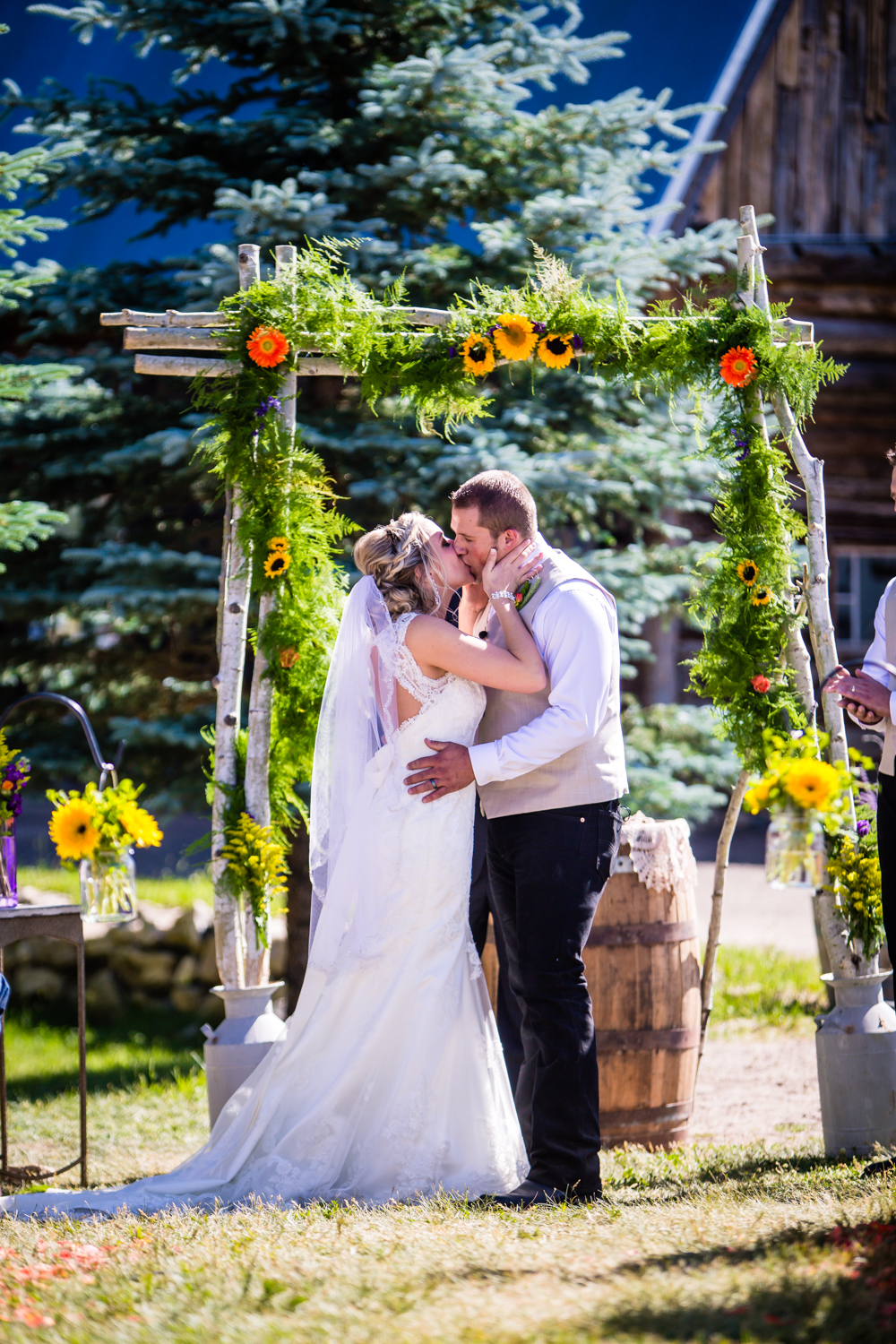 You may kiss the bride. Wedding at The barn at Evergreen Memorial. Photographed by JMGant Photography.