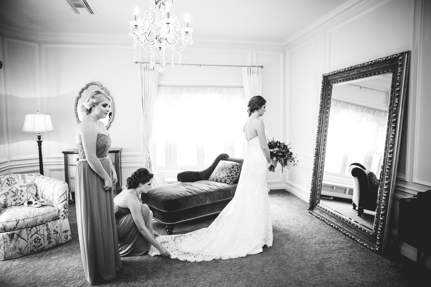 Bride getting ready in bridal suite at Highlands Ranch Mansion. Photographed by JMGant Photography, Denver Colorado wedding photographer.