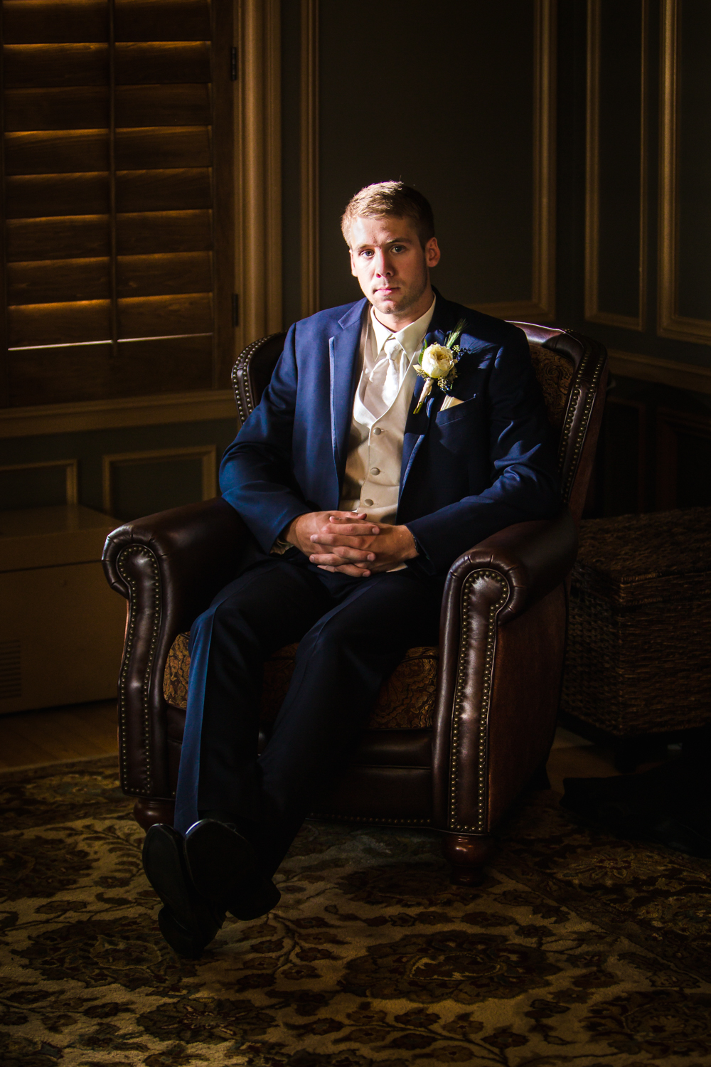 Groom getting ready. Photographed by JMGant Photography, Denver Colorado wedding photographer.