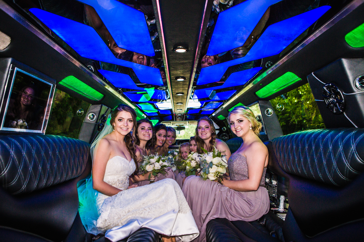 Bridal Party inside a stretch Hummer limo. Photographed by JMGant Photography