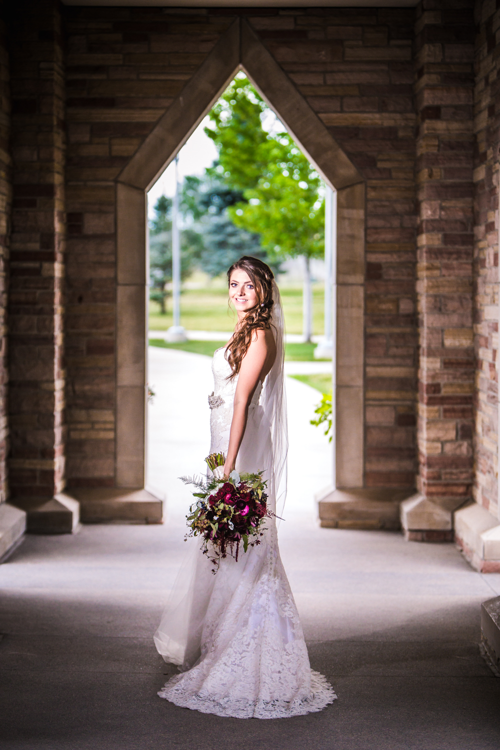 Bride outside Cherry Hills Community Church.   hotographed by JMGant Photography, Denver Colorado wedding photographer.