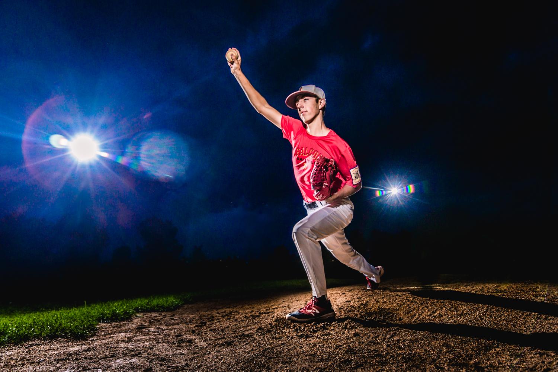 High school senior portraits of baseball player pitching the ball.  www.jmgantphotography.com