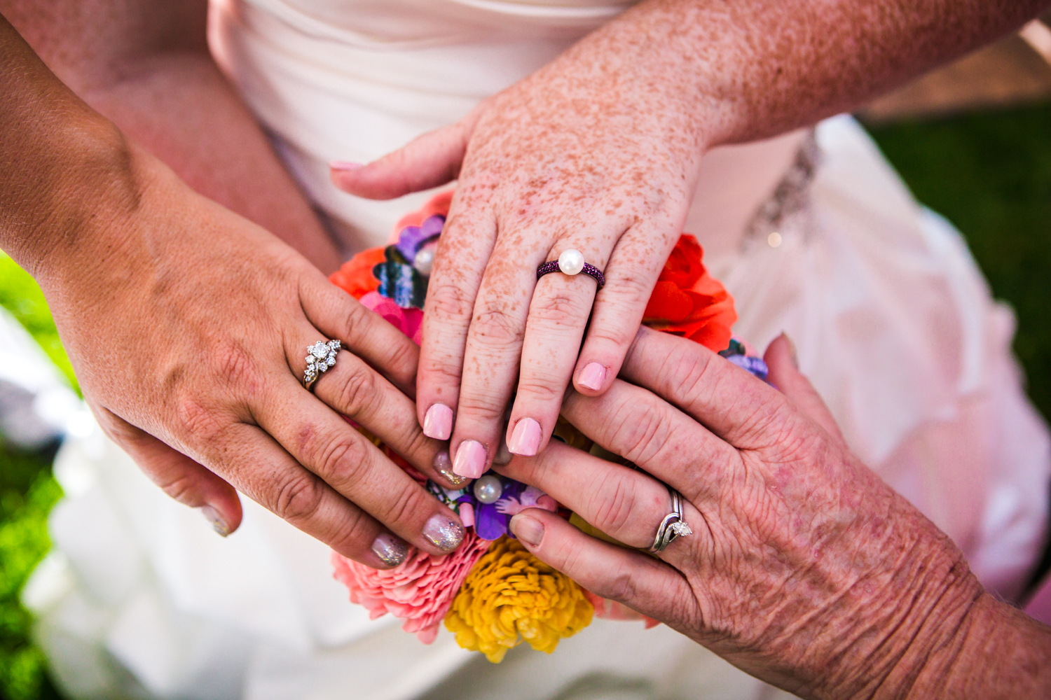 Three generations of wedding rings.Photographed by JMGant Photography.