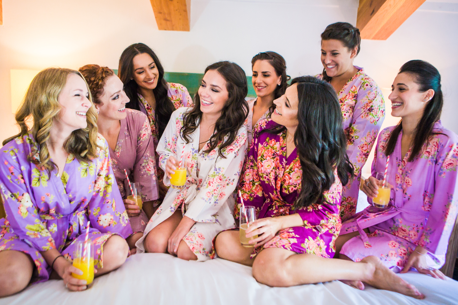Bridesmaids toast prior to their Vail Colorado Wedding photographed by JMGant Photography.