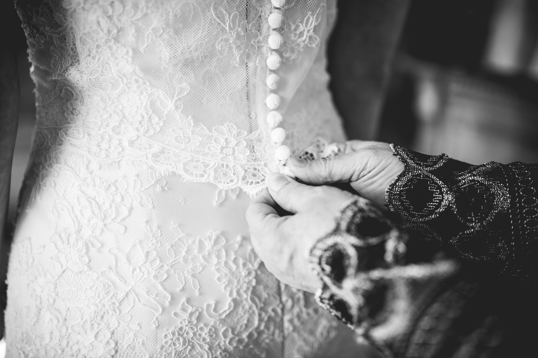 Bride getting in her dress.