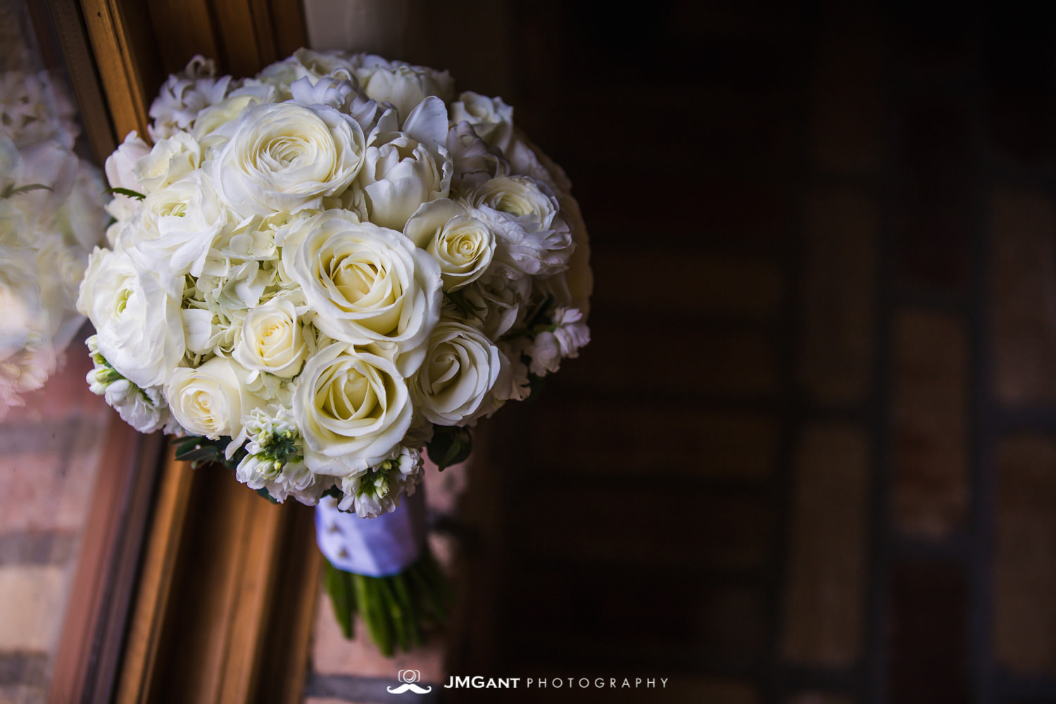 Bridal bouquet by floral designs of europe at an elegant wedding at the Della Terra Mountain Chateau in Estes Park Colorado. Photographed by Jared M. Gant of JMGant Photography.