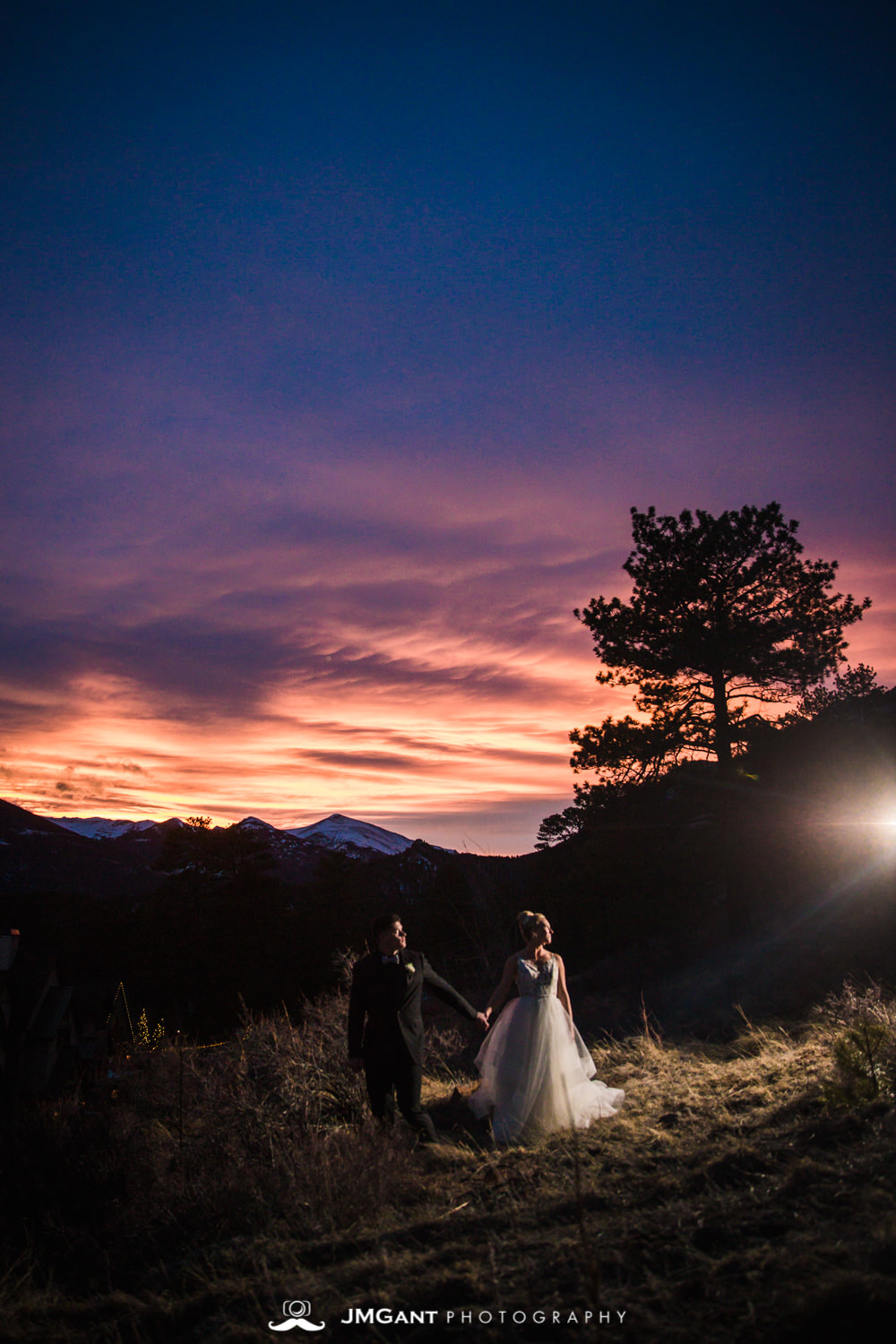 Colorful rocky mountian wedding sunset at the Della Terra Mountain Chateau in Estes Park Colorado. Photographed by Jared M. Gant of JMGant Photography.