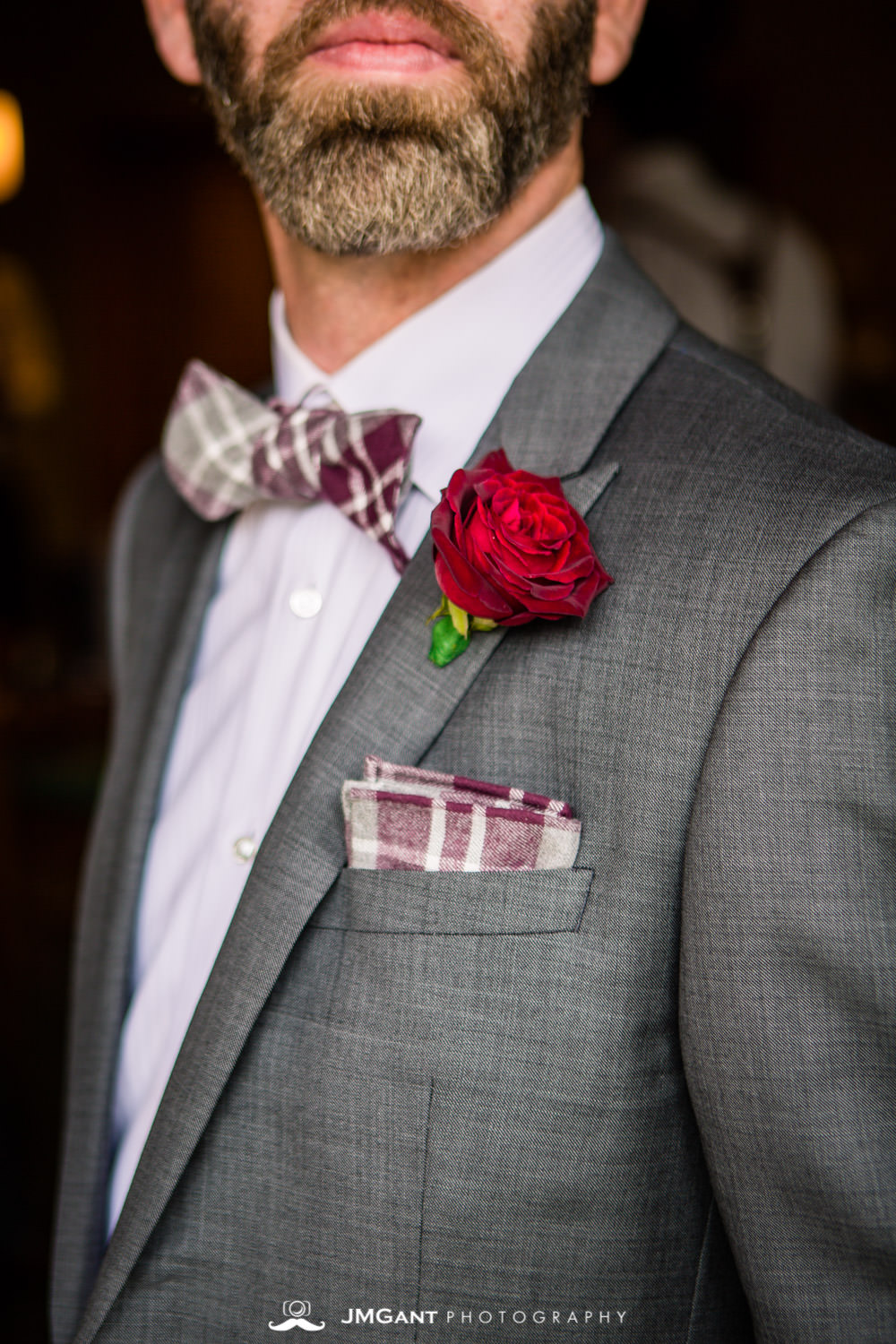 Groom getting ready for a fun Winter Park, mountain wedding at the Lodge at Sunspot, photographed by JMGant Photography