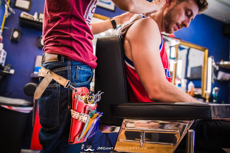 Groomsmen getting ready at the barborshop.
