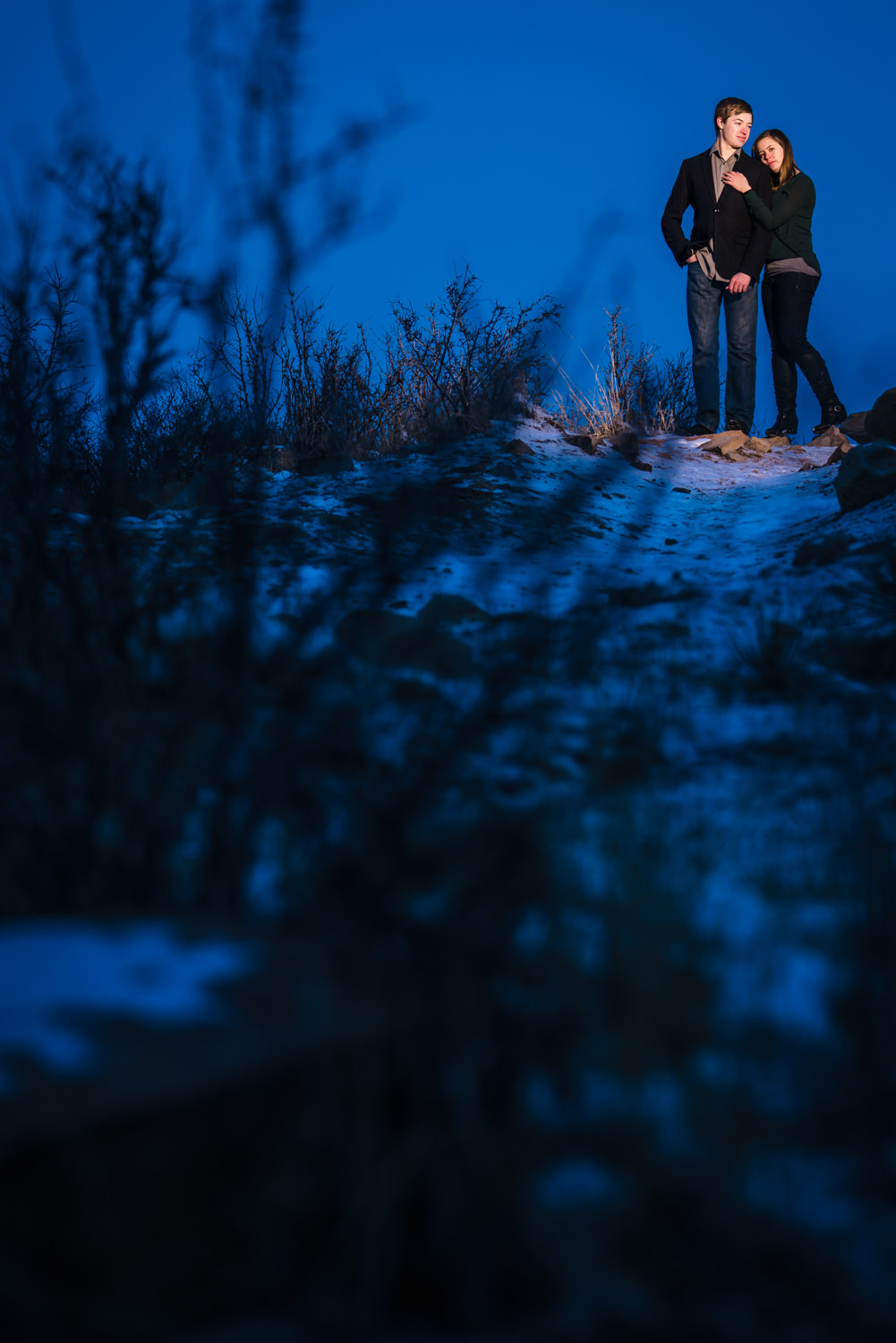 Winter snowy engagement pictures taken at the Horsetooth Reservoir in Fort Collins Colorado. Photographed by JMGant Photography.