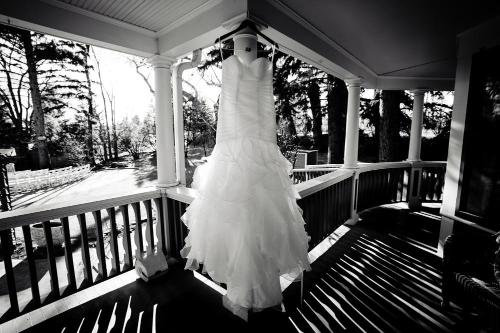 Tapestry House winter wedding by Fort Collins wedding photographer, JMGant Photography - Wedding Dress Hanging
