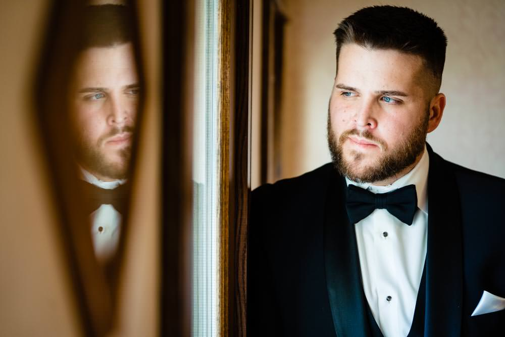 Creative groom portrait - Tapestry House winter wedding by Fort Collins wedding photographer, JMGant Photography
