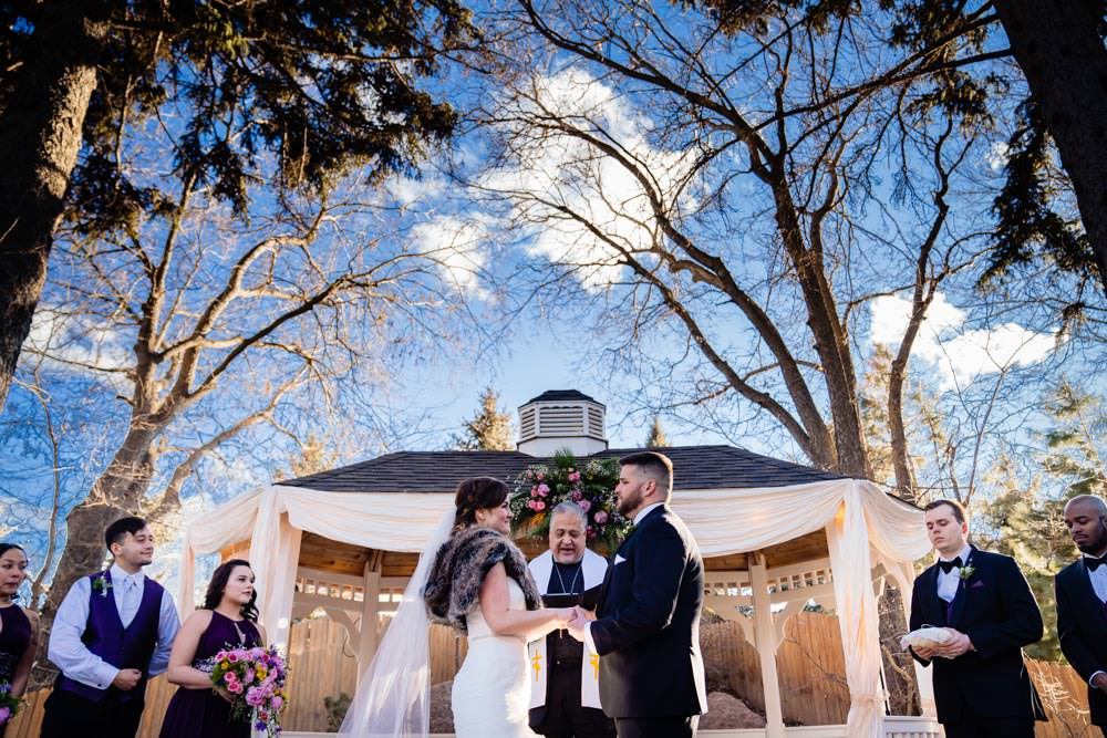 Wedding ceremony - Tapestry House winter wedding by Fort Collins wedding photographer, JMGant Photography