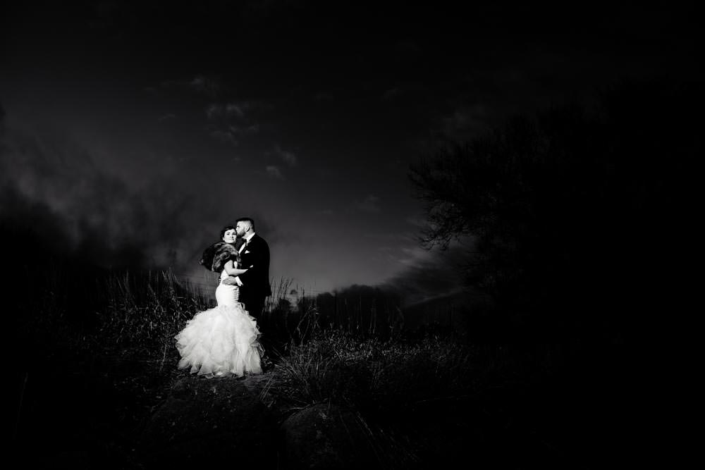 Bride and groom at sunset - Tapestry House winter wedding by Fort Collins wedding photographer, JMGant Photography
